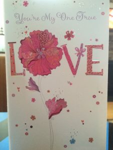 "front of card with word ""LOVE"""